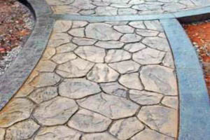 This picture shows San Diego stamped concrete path. The concrete blocks have different sizes.