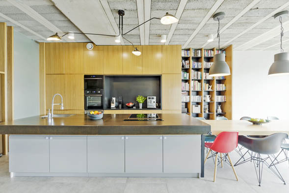 This picture shows a kitchen island made with concrete countertop in a San Diego kitchen. Kitchen is contemporary style.