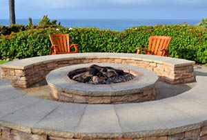 This picture shows a concrete fire pit build on a San Diego patio