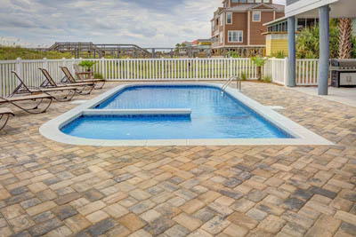 this picture shows concrete pavers pool deck San Diego